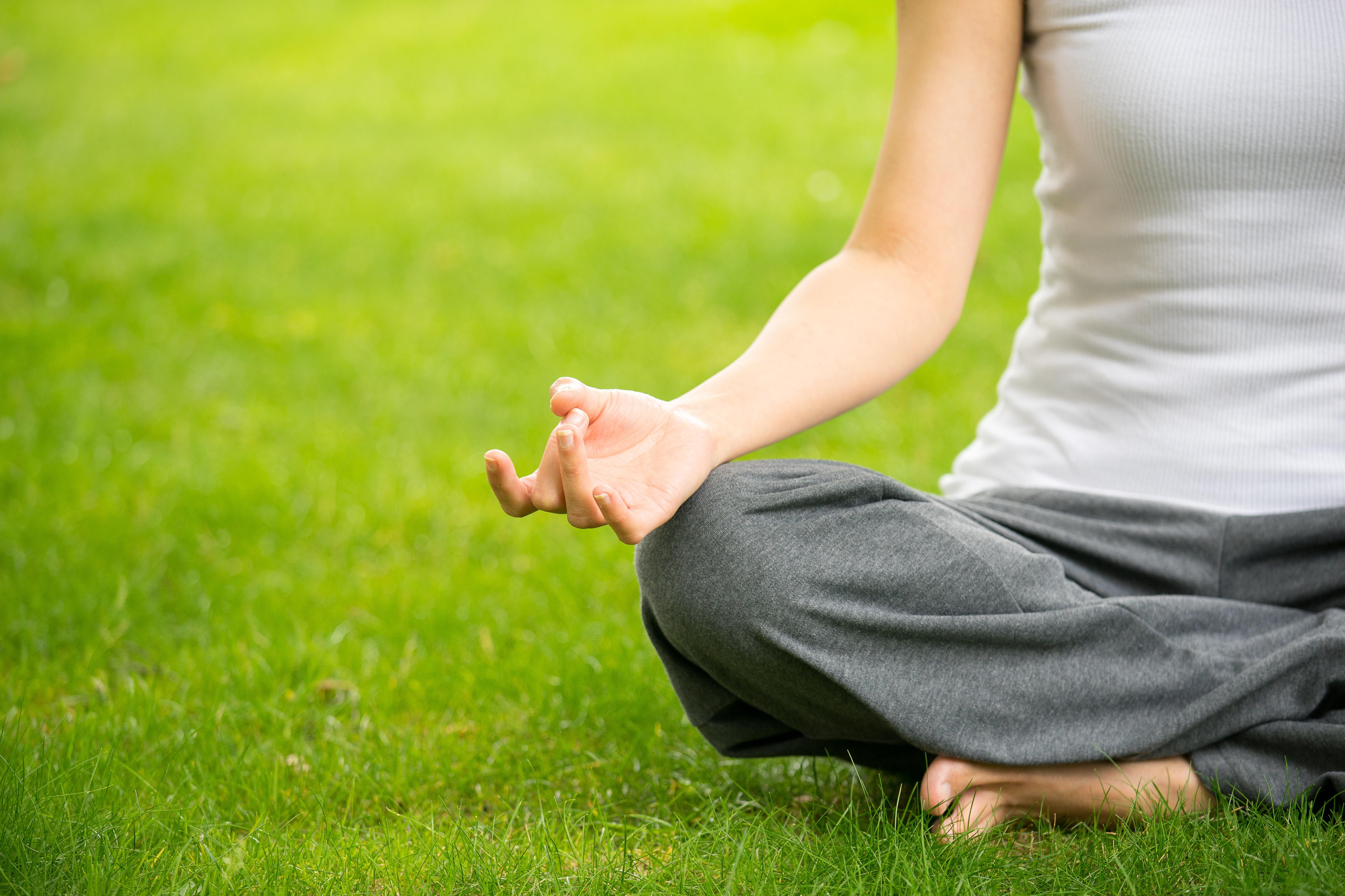 woman meditating and yoga in a park