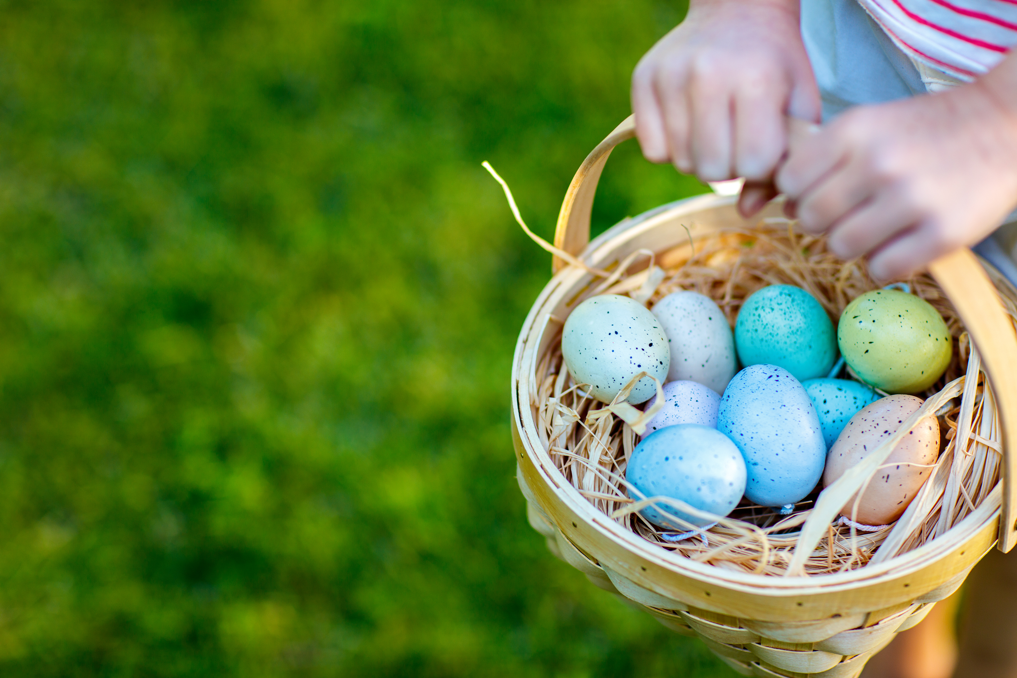 painted eggs in a basket for Easter
